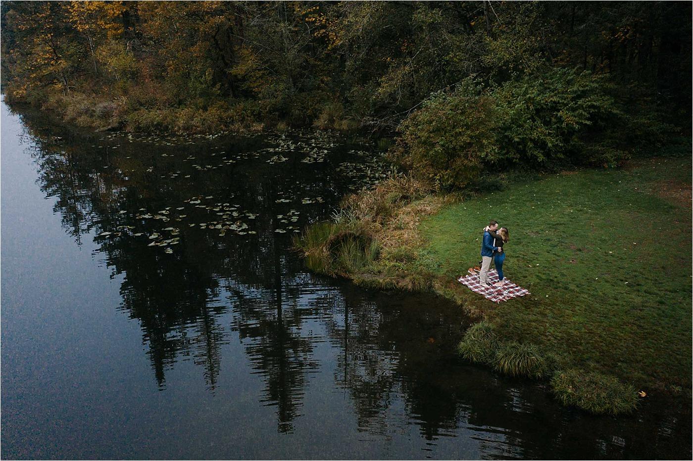 Couple in fallen leaf park during camas Washington engagement session