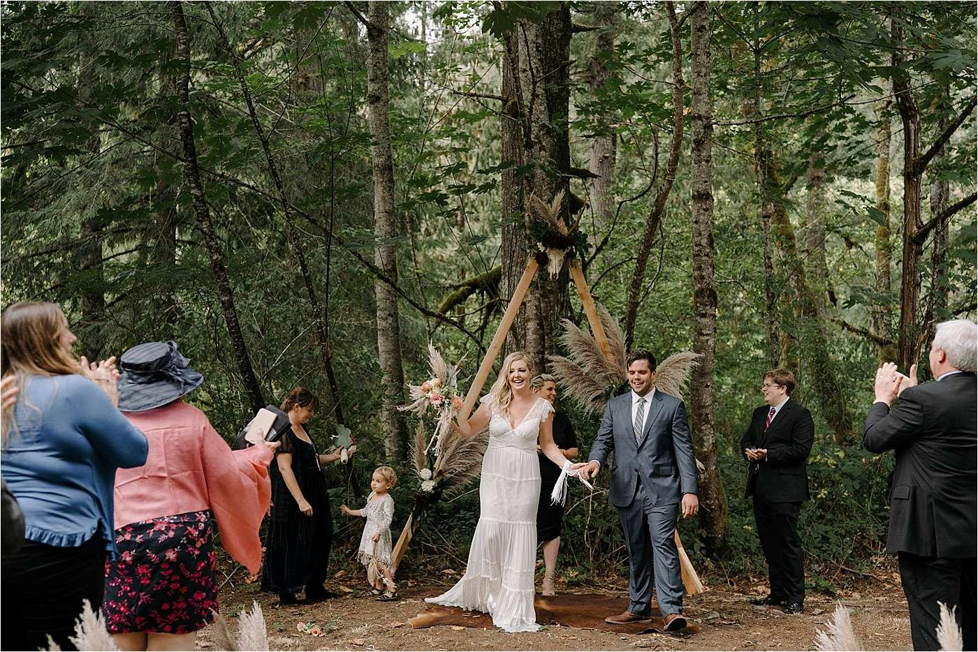 couple celbrating after ceremony during sandy Oregon elopement