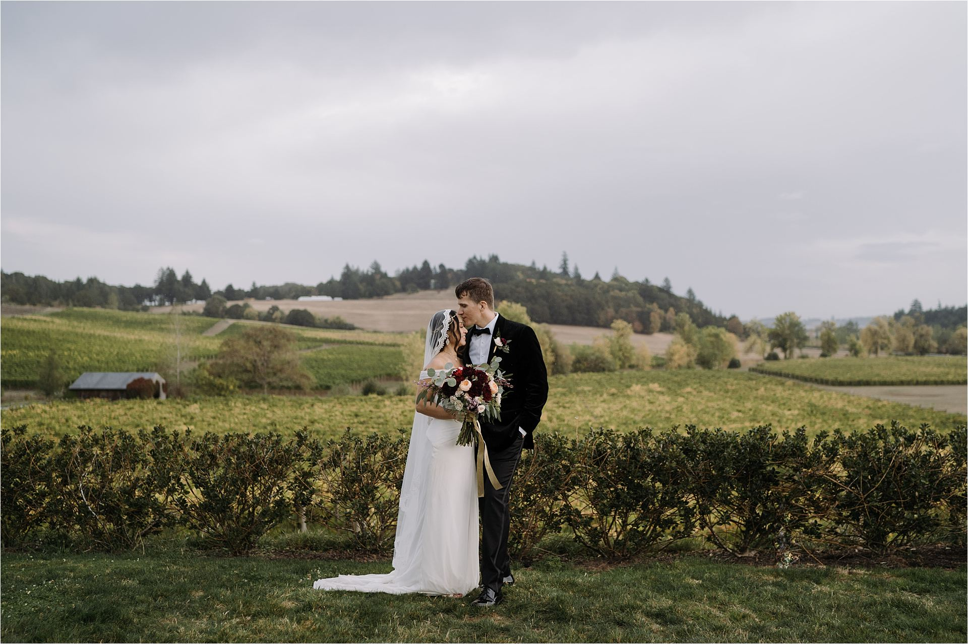 Bride and Groom kissing at the Zenith Vineyard during their wedding