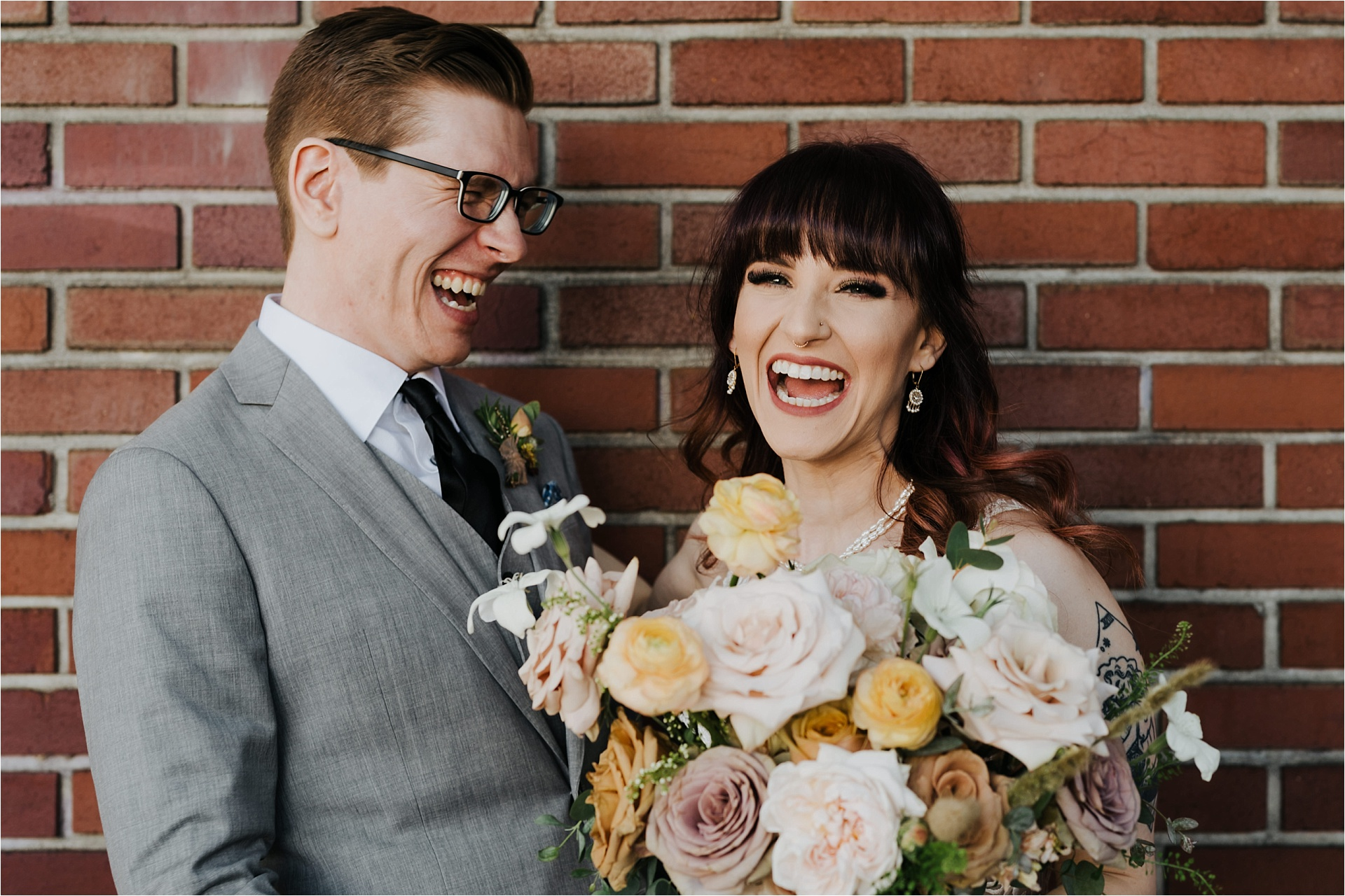 Couple sharing laugh outside of ford building for their tendue wedding
