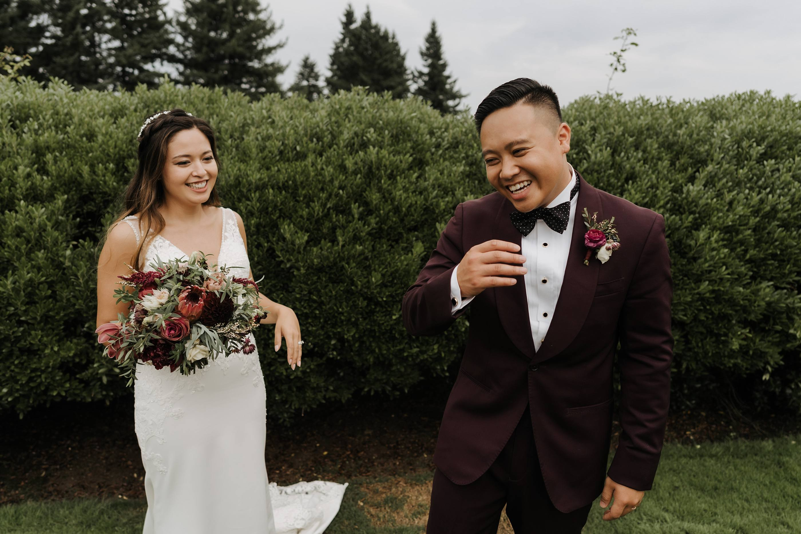Bride and groom share laugh outside at the oregon golf club in west linn oregon