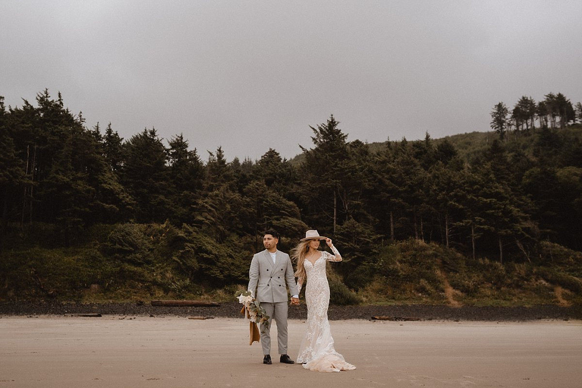 Bride and groom met with strong winds and rain during hug point state park elopement