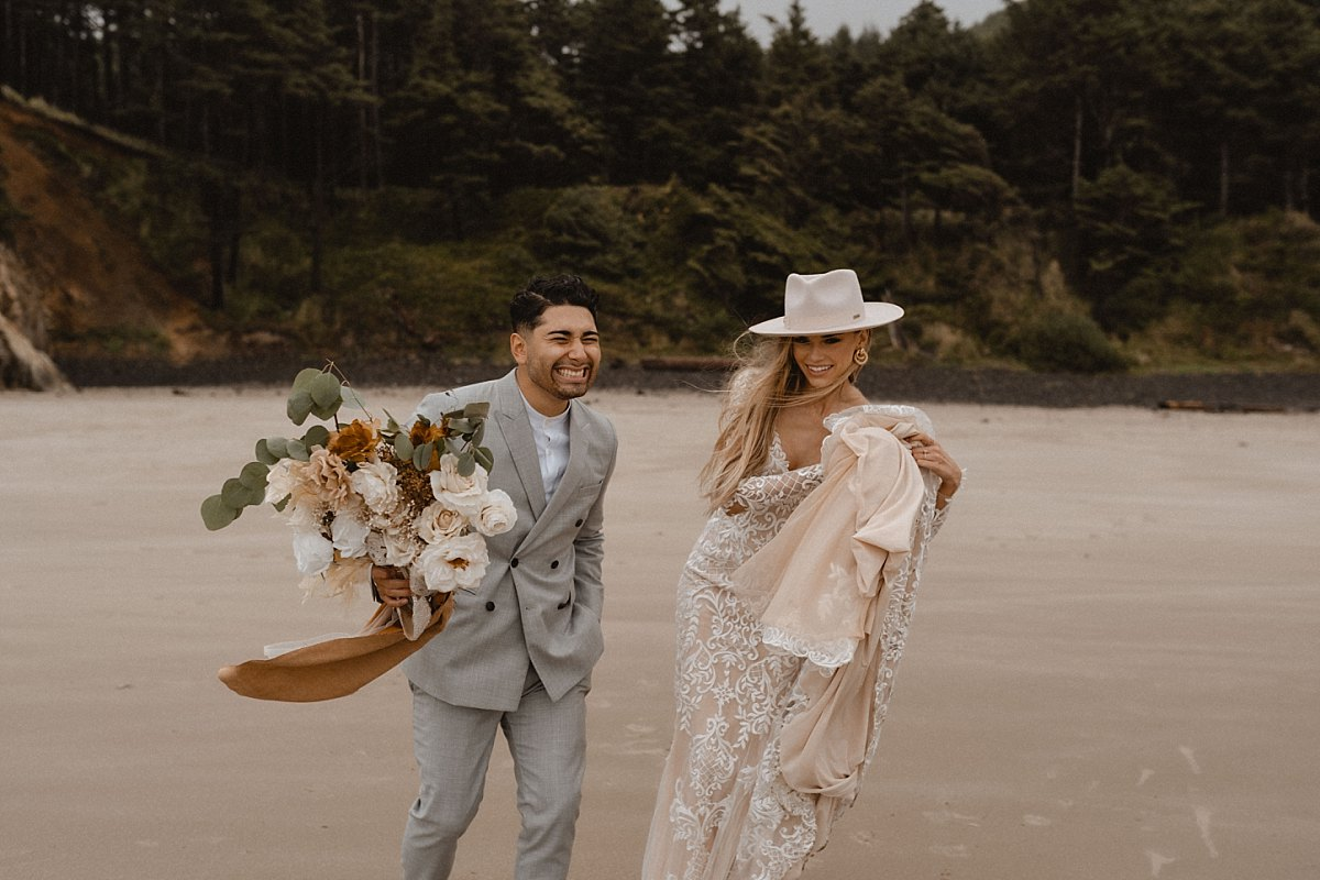 Couple laughing during hug point state park elopement